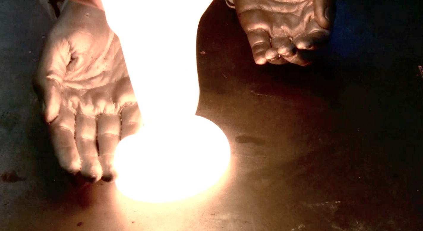 hands to touch molten glass